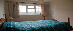 2nd-double-bedroom-with-wooden-floors-cast-iron-fireplaces-and-beautiful-views-at-The-Pink-House-Lulworth