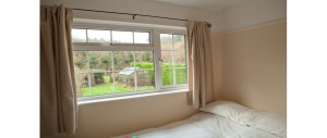 3rd-double-bedroom-overlooking-the-back-garden-at-The-Pink-House-Lulworth