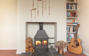 cosy log fires in both lounges downstairs for the colder months at The Pink House Lulworth