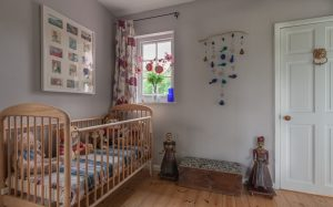 cot room at The Pink House Lulworth Dorset holiday cottage