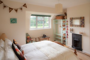 master double bedroom with wooden floors cast iron fireplaces and beautiful views at The Pink House Lulworth