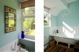 sunny bathroom with garden views at The Pink House Lulworth holiday home Dorset