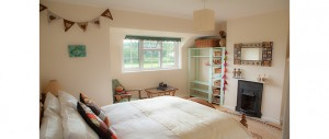 aster-double-bedroom-with-wooden-floors-cast-iron-fireplaces-and-beautiful-views-at-The-Pink-House-Lulworth