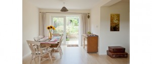 spacious-and-light-filled-dining-area-with-views-to-the-back-and-front-gardens-at-The-Pink-House-Lulworth
