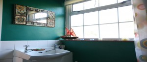 sunny-bathroom-overlooking-back-garden-at-The-Pink-House-Lulworth