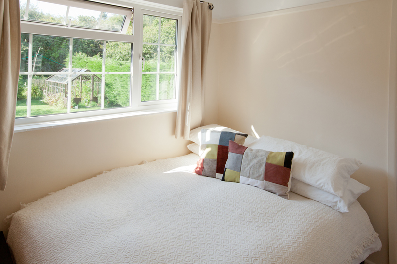 back bedroom with garden views at The Pink House Lulworth Dorset holiday home accomodation