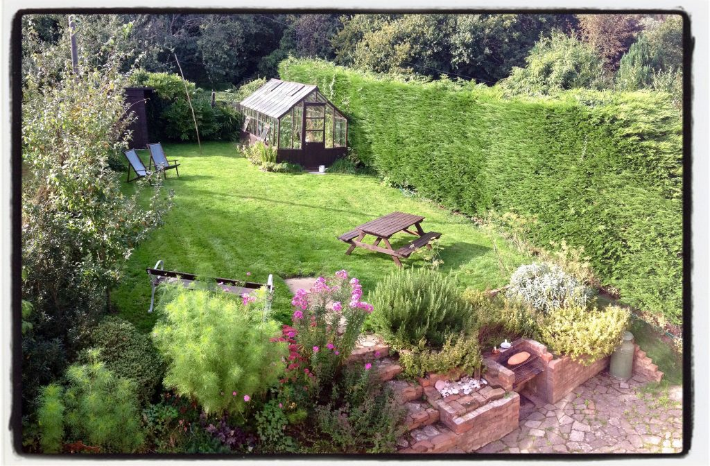 garden view at The Pink House Lulworth holiday home Dorset