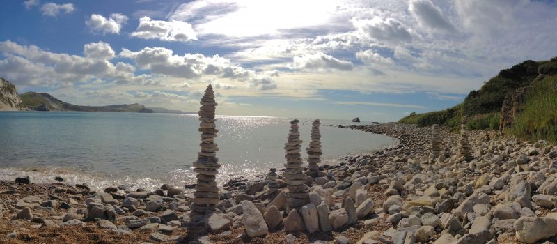 pebble statues at Mupe Bay ©The Pink House Lulworth holiday home accommodation sleeps 8