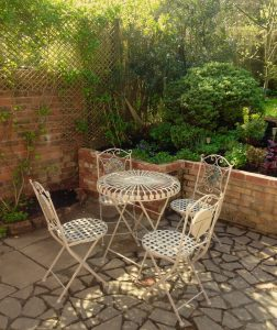 patio dining at The Pink House Lulworth holiday cottage accommodation