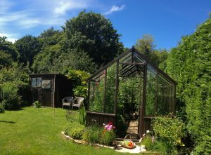 wooden greenhouse in the garden of The Pink House Lulworth