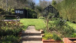 walking through the back garden at The Pink House Lulworth holiday cottage sleeps 8
